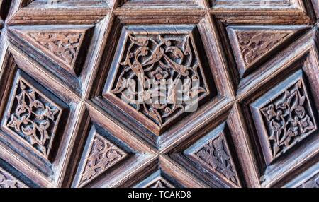 Details of a fine wood carving art on the door. An Islamic art and craft.