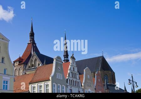 View across hanseatic gables and roofs as well as St. Mary´s Church, New Market, Hanseatic City of Rostock, Mecklenburg-Pomerania, Germany. - Stock Photo