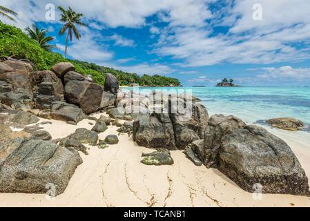 Seychelles seascape with granite boulders in the foreground - Ance Royale Beach in Mahe Island, Seychelles - is one of the favorite places for - Stock Photo