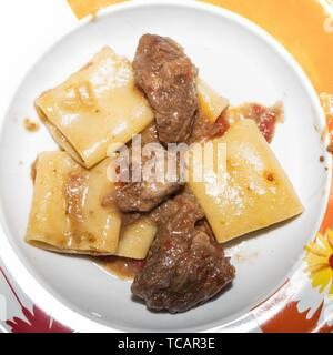 Pasta alla genovese, sauce composed by beef and onions. - Stock Photo