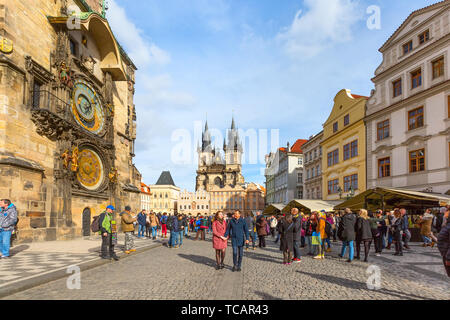 Prague, Czech Republic - February 25, 2017: People at Old Town Square, Stare Mesto in front of Tyn Church and famous Astronomical Clock - Stock Photo