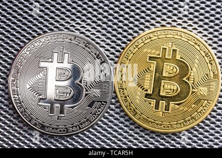 Close up macro shot of bit coins on silver metallic background. - Stock Photo