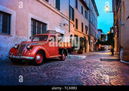 Trastevere street in Rome at sunset Italy. - Stock Photo