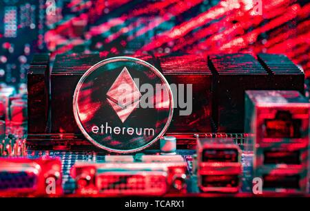 Front view of Ethereum(ETH) cryptocurrency painted with laser stand on computer video card. Bitcoin mining farm concept. - Stock Photo