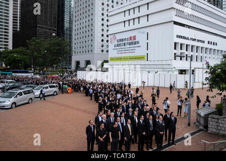 Hundreds of lawyers and legal professionals dress in black take part during the silent march against the extradition bill from the Court of Final Appeal to the Central Government Complex in Hong Kong.  Critics fear any extradition agreement could leave both business figures and dissidents in Hong Kong vulnerable to China's politicized courts, fatally undermining a business hub that has thrived off its reputation for a transparent and independent judiciary. - Stock Photo