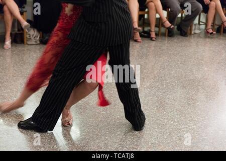 Detail of tango dancers in milonga ballroom. - Stock Photo