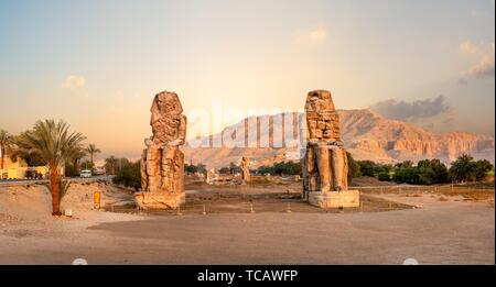 Egypt. Luxor. The Colossi of Memnon - two massive stone statues of Pharaoh Amenhotep. - Stock Photo