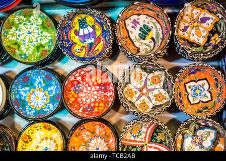 Collection of Traditional Turkish ceramics on sale at Grand Bazaar in Istanbul, Turkey. Colorful ceramic souvenirs. - Stock Photo
