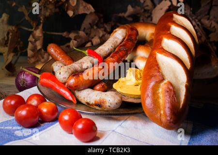 Bavarian White And Red Sausages With Mustard, Bavarian Buns and Pretzels At The Table. October Fest Concept. - Stock Photo