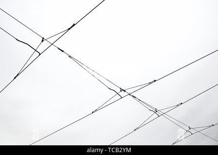 Detail of a catenary and stormy sky. - Stock Photo