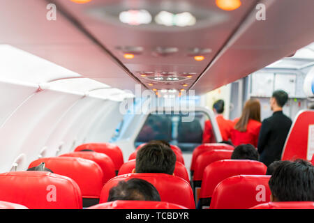 closeup airplane Console panel; lamp, light, need help button, air condition, sefty belt and no smoking lighting sign. - Stock Photo