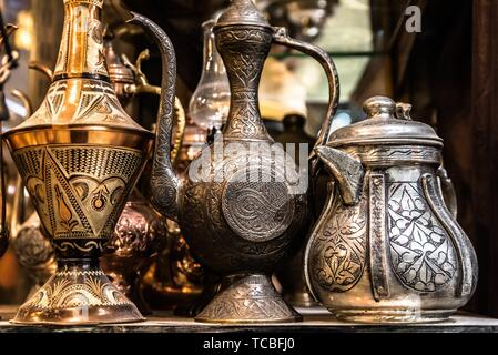 Traditional Turkish copper ewer Souvenirs in Istanbul Grand Bazaar. - Stock Photo
