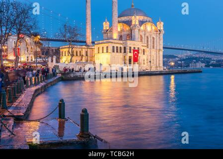 Exterior view of Ortakoy Mosque with15 July Martyrs Bridge or unofficially Bosphorus Bridge also called First Bridge over bosphorus in - Stock Photo