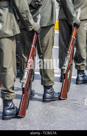 Soldiers stand in row with gun in hand. Army, Military Boots lines of commando soldiers in camouflage uniforms. - Stock Photo