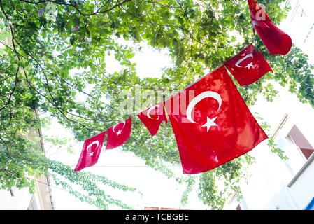 Turkish flags and View of Kadikoy Popular streets where People love walking and visiting. Kadikoy is one of largest popular and cosmopolitan - Stock Photo