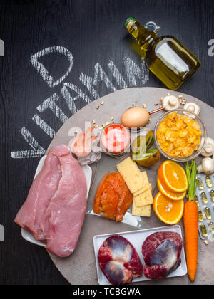 Foods containing vitamin D, pills, oil in glass bottle close up - Stock Photo