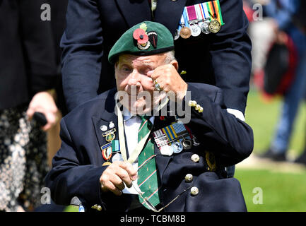 A Normandy veteran reacts after laying a wreath during the Royal British Legion's Service of Remembrance, at the Commonwealth War Graves Commission Cemetery, in Bayeux, France, as part of commemorations for the 75th anniversary of the D-Day landings. - Stock Photo