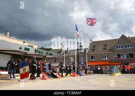Veterans attend a service in Arromanches, France, to commemorate the 75th anniversary of the D-Day landings. - Stock Photo