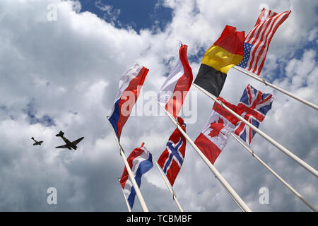 Planes from the Battle of Britain memorial flight pass over Arromanches, France, during a service to commemorate the 75th anniversary of the D-Day landings. - Stock Photo