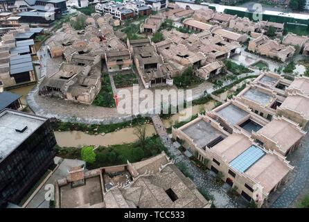 Nanchang. 6th June, 2019. Aerial photo taken on June 6, 2019 shows a view of Wanzai ancient town in Wanzai County of Yichun, east China's Jiangxi Province. Homestay tourism in Wanzai County is booming as local government has made constant efforts in integrating culture industry and tourism. Credit: Peng Zhaozhi/Xinhua/Alamy Live News - Stock Photo