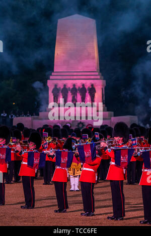 London, UK. 06th June, 2019. The Household Division Beating Retreat on Horse Guards Parade. A blend of music, video played across two gigantic screens, and precision marching, the troops tell the story of how the regiments of the Household Division, The King's Troop Royal Horse Artillery and The London Regiment have a long and distinguished history of serving the Monarchy and the United Kingdom. Credit: Guy Bell/Alamy Live News - Stock Photo