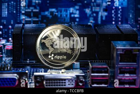 Front view of Ripple(XRP) cryptocurrency over computer video card. Bitcoin mining farm concept. - Stock Photo