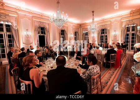 Guests enjoy a gala dinner hosted by U.S President Donald Trump and First Lady Melania Trump at Winfield House June 4, 2019 in London, England. - Stock Photo