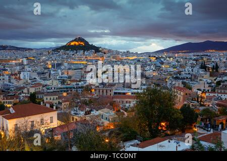 View of Lycabettus hill from Anafiotika neighborhood in the old town of Athens, Greece.. - Stock Photo