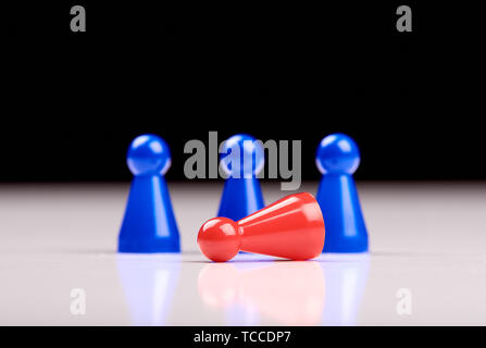 Standing three blue game pieces as winner and lying red figurine as loser on white table top with black background. Space for your text.