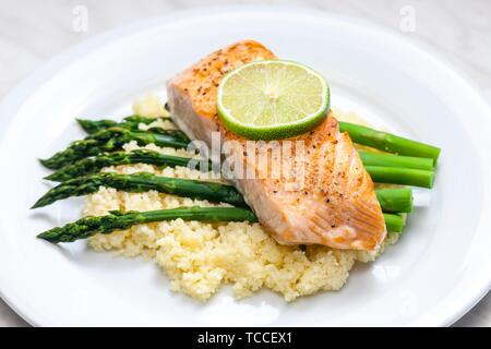 salmon with asparagus and couscous. - Stock Photo