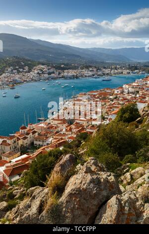 View of the Chora village of Poros island and Galatas village in Peloponnese from a nearby hill, Greece.. - Stock Photo