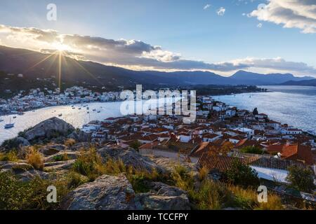 View of the Chora village of Poros island and Galatas village in Peloponnese, Greece.. - Stock Photo