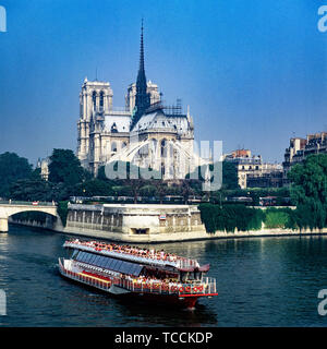 Bateau Mouche sightseeing river Seine cruise boat, Notre-Dame de Paris cathedral before fire of April 15, 2019, east facade, Paris, France, Europe, - Stock Photo