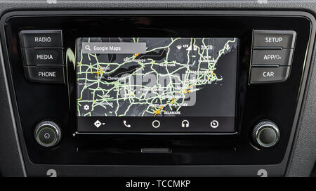 LOS ANGELES, CALIFORNIA - JUNE 6, 2019: Close up to male driving and using navigation appliction Google Android Auto. An illustrative editorial image. - Stock Photo