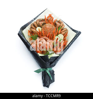 Luxurious gift to friends in the form of a bouquet of cooked shrimps, crayfish, crab on a white background - Stock Photo