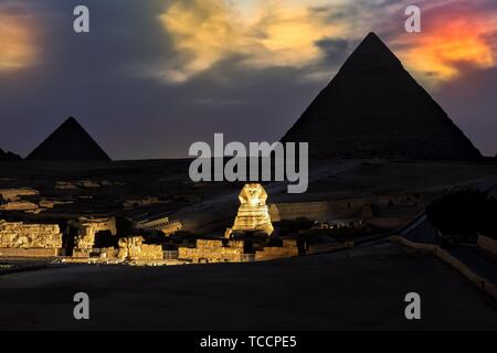 The Pyramids and the Sphinx in the evening show lights, Giza. - Stock Photo
