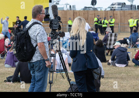 A camera crew setting up for a live broadcast - Stock Photo