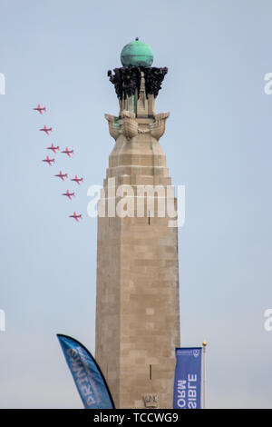 The RAF red arrows flying in formation during an airshow at the d-day 75 commemorations in Portsmouth - Stock Photo