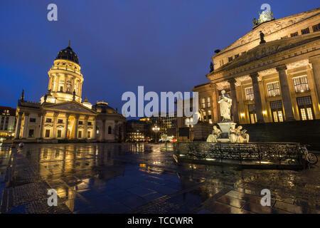 Illuminated Schiller Monument, Neue Kirche (Deutscher Dom) and Konzerthaus Berlin (Berlin Concert Hall) at the Gendarmenmarkt Square in Berlin at dusk - Stock Photo