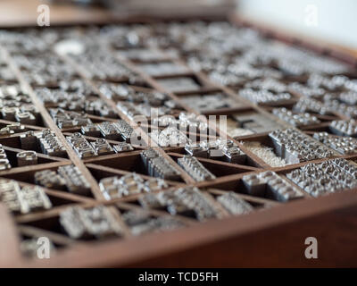 Typeface letters arranged for use in printing press machine - Stock Photo