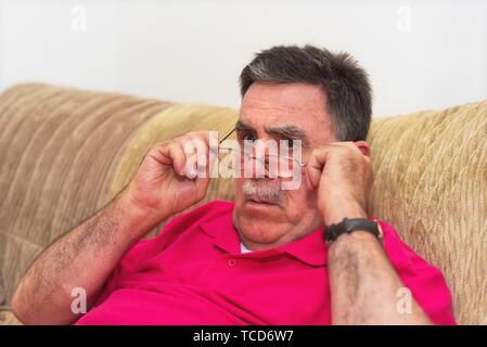 Closeup portrait senior, elderly man in glasses, looking shocked. - Stock Photo