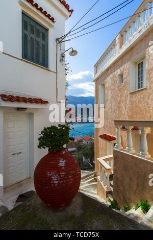Street with a sea view in Chora village of Poros island in Greece.. - Stock Photo