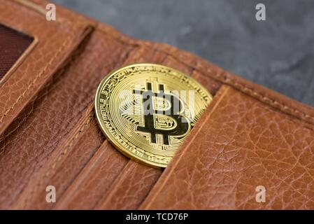 View of metal bitcoins in brown leather wallet. Concept image for cryptocurrency. - Stock Photo