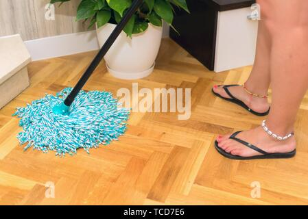 House wife cleaning floor at home. Domestic chores. - Stock Photo
