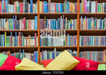 Bookshelf in public library, front view, horizontal. - Stock Photo