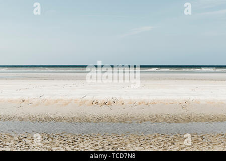 Beautiful Minimalistic layered seascape with green and yellow tints - Stock Photo