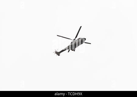 Military navy helicopter flying isolated on white background - Stock Photo