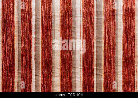red striped synthetic woven upholstery fabric close-up texture - Stock Photo