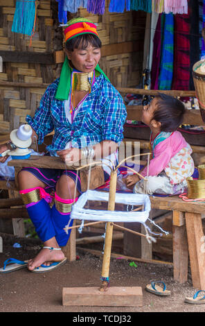 Portrait of Kayan tribe woman in Kayan state Myanmar - Stock Photo