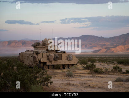 Oregon Army National Guard, M3A2 Bradley Fighting Vehicle from the 3rd Battalion, 116th Cavalry Regimen, 116th Cavalry Brigade Team provides security for the tact assembly area  at the National Training Center, Fort Irwin, California, June, 5, 2019. The Bradley is designed for transporting troops and providing cover fire. (U.S. Air National Guard photo by Senior Airman Mercedee Wilds) - Stock Photo